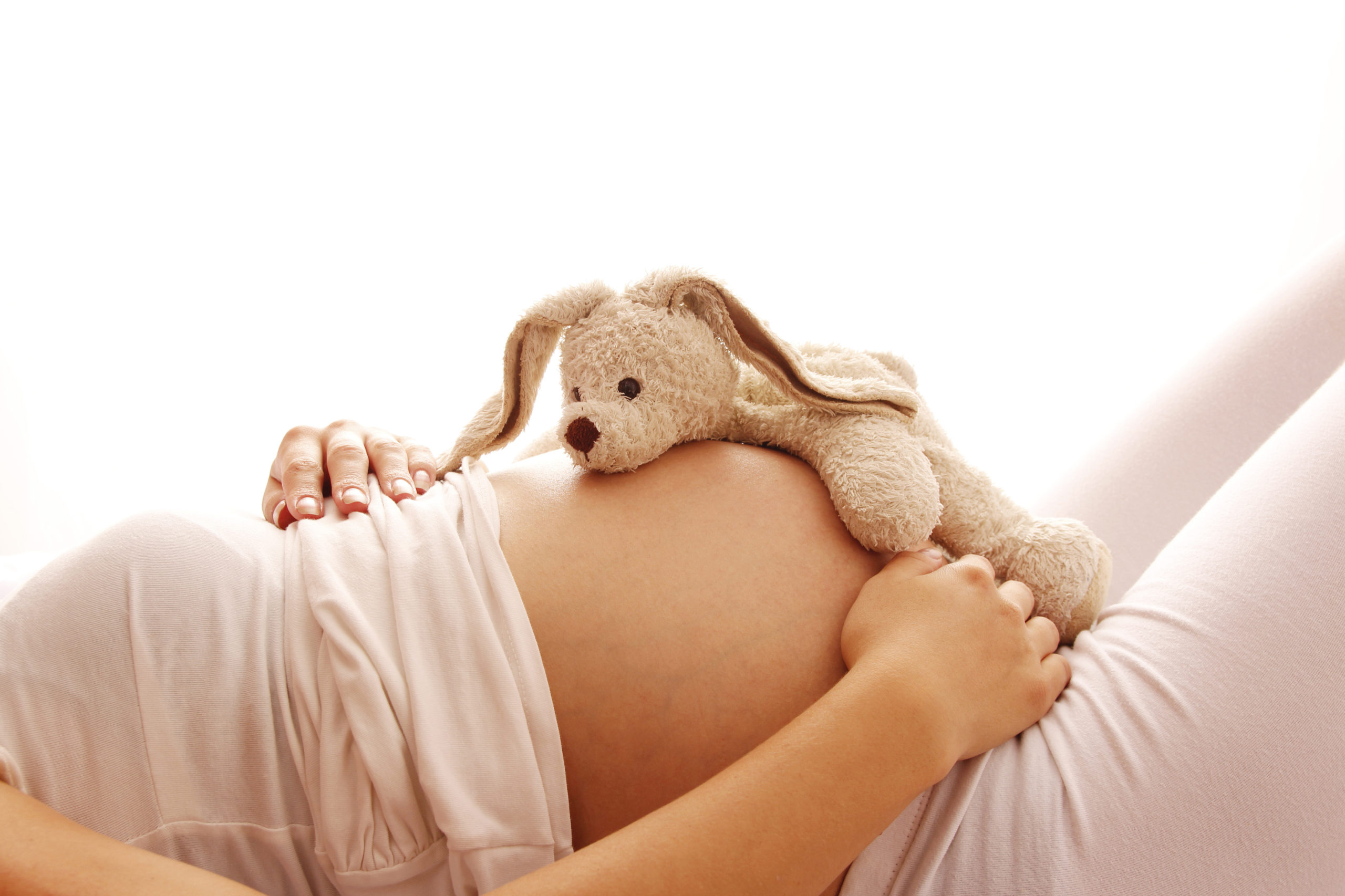 a pregnant woman on a white background